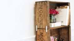 Learn how to make this crate bookshelf! This bookshelf looks super expensive, but it's made with antique crates and simple hardware. The rustic bookshelf wil...