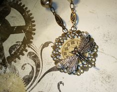 Steampunk necklace with old watch face and silver dragonfly Old Watches, Bubble Envelopes, Steampunk Necklace, Watch Faces, Beige Color, Steampunk Fashion, Necklace Lengths, Bronze, Pendant Necklace