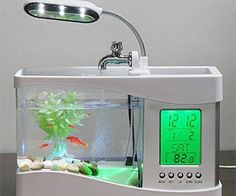 Get the ultimate nightstand centerpiece for your room with the mini aquarium clock. This multifaceted appliance is 50% pet, 30% appliance, 20% storage device and 100% useful. It's the only functioning alarm clock that contains an adjacent LED lit fish tank. Buy It $39.65 via Amazon.com