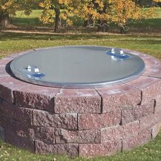 The Pilot Rock Round Steel Fire Ring Cover keeps your fire ring dry between uses and eliminates the hazard of fire spreading after use. This cover . Paver Fire Pit, Diy Fire Pit, Fire Pit Backyard, Stone Fire Pits, Cheap Fire Pit, How To Build A Fire Pit, Backyard Patio, Rustic Outdoor, Outdoor Fire