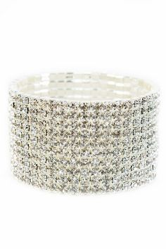 Break out your spandex bell bottoms and platform shoes because you're going to the disco with Aurora on your wrist. This crystal stretch cuff adds glamorous bling to your look so you can channel your inner starlet. Aurora is a statement bracelet that should definitely be shown off with a slinky black or silver LBD and stilettos for a night on the town. Fits small wrists best. Available at sendthetrend.com.