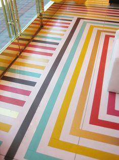 Rainbow striped floor at Kate Spade, via Decor Hacks