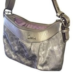 Coach Silver And Gray Cross Body Bag. Get the trendiest Cross Body Bag of the season! The Coach Silver And Gray Cross Body Bag is a top 10 member favorite on Tradesy. Save on yours before they are sold out!