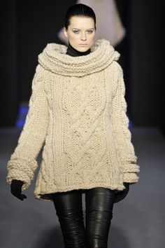 .interesting collar and cuffs on a oversized sweater. Buttons up the back, possibly