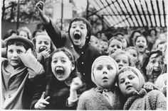 [CasaGiardino]  ♡  Photo was taken in Paris in 1963 of children watching a puppet show. The mix of honest looks of delight and horror are priceless.  (Life)