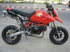 I've seen all kinds of different custom looks for the Grom, however how do you think the Grom would look setup like a supermotard? Any fans of that look on. Grom Bike, Honda Grom, Small Motorcycles, 125cc, Pocket Bike, Pit Bike, Custom Bikes, New Toys, Ducati