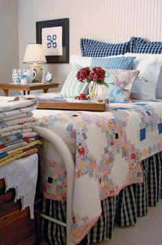 Patchwork quilt combined with gingham pillows and bed skirt.