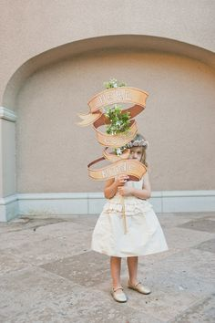 #signs, #sign-bearer  Photography: onelove photography - onelove-photo.com Event Planning & Design: Fresh Events Company - fresheventscompany.com/ Floral Design: Ixora Florist - ixoraflorist.com/  Read More: http://www.stylemepretty.com/little-black-book-blog/2013/04/17/altadena-california-wedding-from-onelove-photography-fresh-events-company/