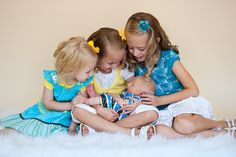 Newborn baby boy with his three older sisters.  So sweet. @Wendy Freeman Nelson
