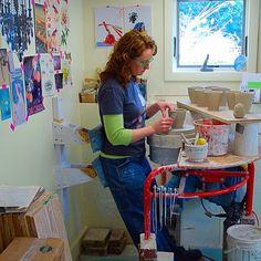 Kristen Kieffer standing to throw in home studio