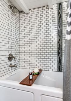Yep, that's a full-size Jacuzzi tub for when you need to get away from your stressful tiny house lifestyle. And with it's subway-tile backsplash and bold dark grout, it's a bathroom design that would make a statement in a home of any size. Click through for more design inspiration from this stunning tiny house.