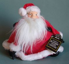 This is a 1993 Applause Santa from Tim Burton's Nightmare Before Christmas. In old stock condition with both the paper and plastic hang tags. About 10 inches tall.