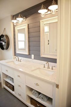 Great looking bathroom with grey shiplap treatment.