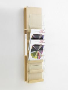 Wall-mounted display unit for brochures Front Collection by Karl Andersson & Söner | design Skala Design