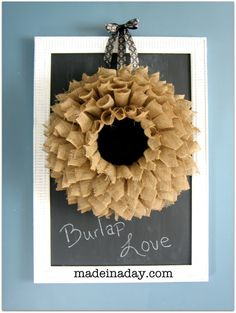 Tutorial to make this burlap wreath. I like the idea of tucking different things up in there, depending on the season. (dried flowers in spring/ summer, leaves in fall, christmas ornaments in winter...)