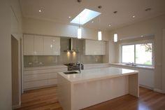 White cupboards with greyish splashback - Beige Royal (Dulux) on Starfire glass | Kitchens I like