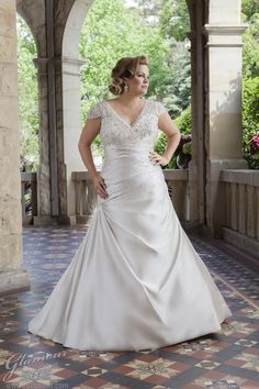 Brand: Glamour plus Style: Abella Style Code: 5630T  Strapless gown with pleats wrapping to the hip and opening into a narrow skirt.  #glamourplus #bridal #plussize #fullerfigured #bridalgowns #weddingdresses #rozlakelin #weddings #dress #bride #readytowear