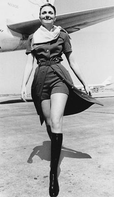 A TWA stewardess models the new uniform with knee-high boots that the airline has introduced in New York City, June The TWA mini pants will be worn with a safari shirt dress. (AP Photo) ORG XMIT: [Via MerlinFTP Drop] Air Hostess Uniform, Safari Shirt, Hippie Man, Flight Attendant Life, Attendance, Up Girl, Vintage Photos, Packing Tips, Travel Packing