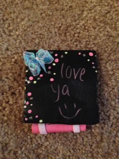 DIY chalkboard I made these smaller so it could fit into my school locker but you can make them any size! All I did was paint thick foam board with chalk board paint and added a cute mini bow and decorated it with some colorful polka dots! I also added a ribbon to hang it with