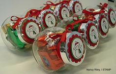 Cute little Spice Jars filled with candy...decorated with ribbon and topped off with a image on the lid.