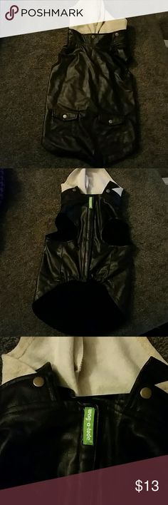 Dog clothing lrf Faux leather puffer jacket with hood size large.  Petco product.  See pictures for measurements.  Inner material is soft and the outside feels like leather.  Pockets do not open. Open area on back to attach leash.  Hood is removable. Other