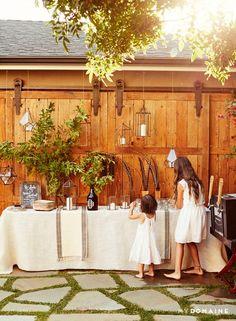Buffet table set up at Meritt Elliott and John Rankin's backyard dinner party