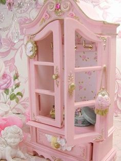 Beautiful pink jewlry box.This could easily be a stunning armoire...  Look on craigs list for used armiore. lightly sand, prime let dry 24 hours paint same color pink and use wall paper or wrapping paper for back wall and drawer liner....