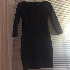 Little Black Dress Plain & simple body fitting little back dress. Great condition. Mid sleeves and stops above the knees Forever 21 Dresses