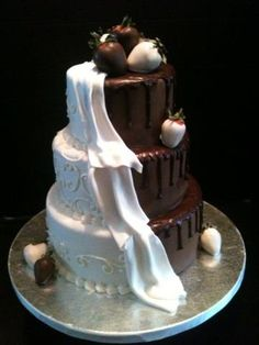 The most requested cake for 2013 weddings so far. I was brought a photo of the original cake which I believe was done by Shockley's Sweet Shoppe, the Mother of the bride wanted only 3 tiers and strawberries used as the topper. All fondant, with chocolate ganache drip.