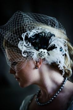 Not sure if I'm doing a veil or just a fascinator but I do like this one