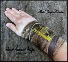 SteamPunk Cuff - Industrial Wrist Cuff - Post Apocalyptic Cuff Leather Brass gears FEATURES: STEAMPUNK INDUSTRIAL WRIST CUFF * Hand sewn textile wrist cuff * Genuine brown lambskin leather * Genuine brown suede leather * Steampunk post apocalyptic styling * Salvaged scraps of