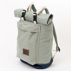 Designed in Portland, the Zipper Roll Top Backpack stands up to any weather; it's made with waterproof, treated canvas to keep goods dry.
