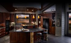 dark brown cabinets with black appliances