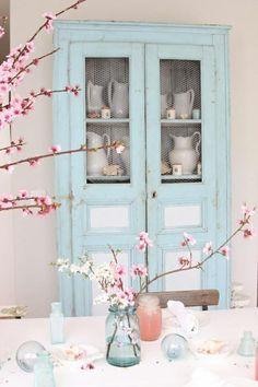 Light blue hutch with pink cherry blossoms
