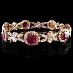 Beautiful and delicately designed bracelet with eight graduating ruby and diamond clusters inbetween stylised floral diamond-set motifs Edwardian, circa 1910