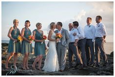 Cayman Islands destination wedding with teal bridesmaids dresses and tropical bridesmaids bouquets
