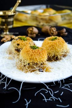 Kadayif stuffed with walnuts and coated with sweet syrup | giverecipe.com | #kadayif #dessert #turkish