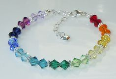 Swarovski Crystal Spectrum Rainbow Beaded bracelet by BestBuyDesigns Swarovski Bracelet, Swarovski Crystal Beads, Swarovski Jewelry, Crystal Bracelets, Crystal Jewelry, Silver Beads, Bead Jewellery, Beaded Jewelry, Handmade Jewelry