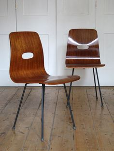 Robin Day; Molded Walnut Plywood and Enameled Metal 'Q-Rod' Chairs for Hille, 1953.