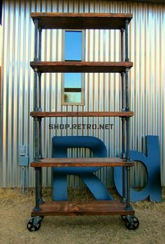 Industrial shelving made from recycled lumber and pipe.