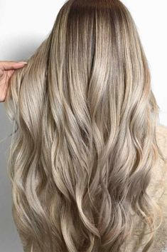 Check out 24 of the hottest long hair styles for a flirty new look! Are you bored with your long hair and looking for new sexy styles? Look no further! #hairstyle #haircuts #haircolor