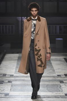 Camel continues its reign with the help of moth print embellishments.   Alexander McQueen Fall 2016 Menswear Fashion Show