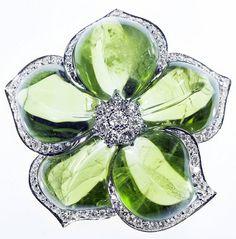 Van Cleef & Arpels Peridot and diamond flower brooch....gorgeous