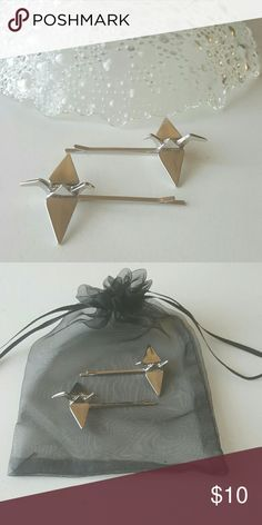 "(2x) Silver Origami hair pins ""I will write peace on your wings and you will fly all over the world"" -Sadako Sasaki  This listing is for 2 Silver metal origami paper crane hair pins. I do have other colors please check out my other listings. These have never been used but do not come with tags, it does come in a jewelry bag for storage and presentation. This is a no name brand, not Anthro. Price firm, 15% off bundles Accessories Hair Accessories"