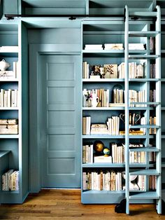 Great ideas for home decor with small spaces.  For bookcases, think up not out. In this picture, the book case slides open to reveal the door to a bathroom. That is your home decor tip For Pinterest tips sign up for our Pinterest eNewsletter by clicking on pin.