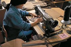 In the factory, hand finished touches help to give each Filson bag character.