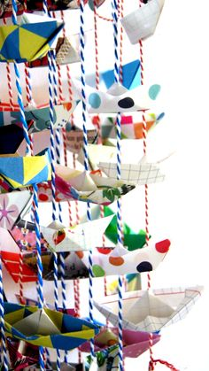 For inspiration for what to do with all of those paper boats after you've made them, check out this fun hanging mobile idea! #paperboat