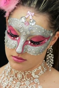 Very sparkly and creative crystal accented pink and silver masquerade make-up mask By Priscilla Muse.