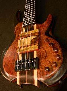 SWEET Bubinga and Wenge Carved Top 5string by Wyn Guitars. I especially love the pickups XD