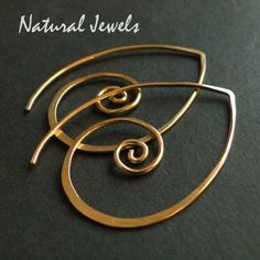 These earrings are so comfortable! You put the long pin through your ear and wow... different, simple yet outstanding. These earrings are available in different sizes and also in Sterling Silver as shown in one of the pictures, these small ones are the left ones on the picture. The model is wearing the big silver spirals. - authentic and handmade - 14Karat Goldfill - total length 3,4 centimeters All materials are 14K Goldfill. 14K Goldfill means that 5% of the material is real 14K Gold…